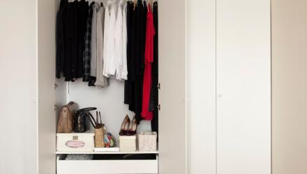 a neat and organized closet with clothes