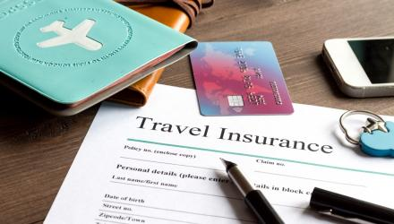 travel insurance papers and passport